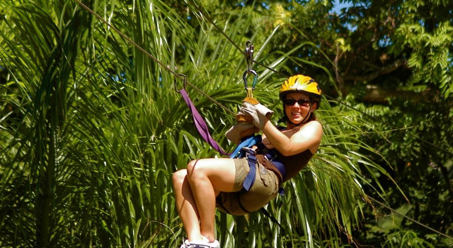 Girl in on a zipline in the Roatan Canopy.