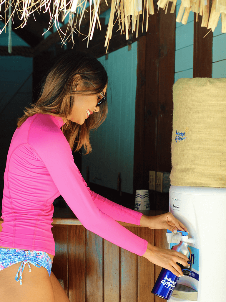 Girl refilling a water bottle at Anthony's Key Resort.